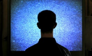 silhouette-of-head-in-front-of-blank-tv-screen